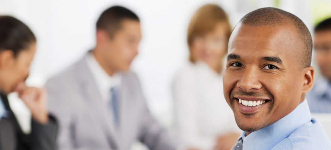 Successful group of businesspeople working together on a meeting.  The focus is on the African man looking at the camera in the foreground.   [url=http://www.istockphoto.com/search/lightbox/9786622][img]http://dl.dropbox.com/u/40117171/business.jpg[/img][/url]  [url=http://www.istockphoto.com/search/lightbox/9786738][img]http://dl.dropbox.com/u/40117171/group.jpg[/img][/url]